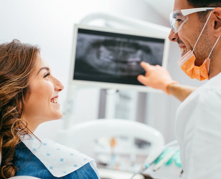 dentist explaining an x-ray to a patient