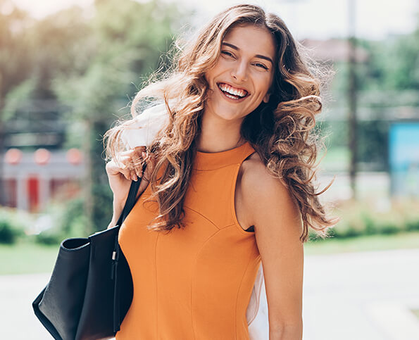 woman laughing and walking