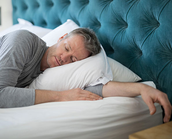 middle aged man sleeping